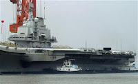 China's first aircraft carrier, which finished its maiden sea trial and arrived at Dalian Port, Liaoning province August 14, 2011.