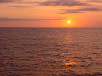 Sunset & dolphins on the high seas