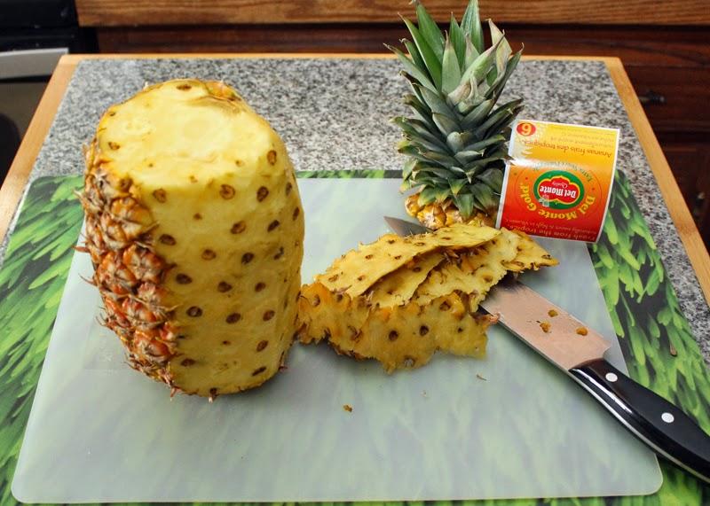 Pineapple - cut away the skin.