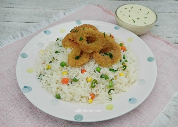 Complete meal in no time at all ! Delicious Calamari, served over Veggie Rice and a Garlic-Lemon Dip on the side