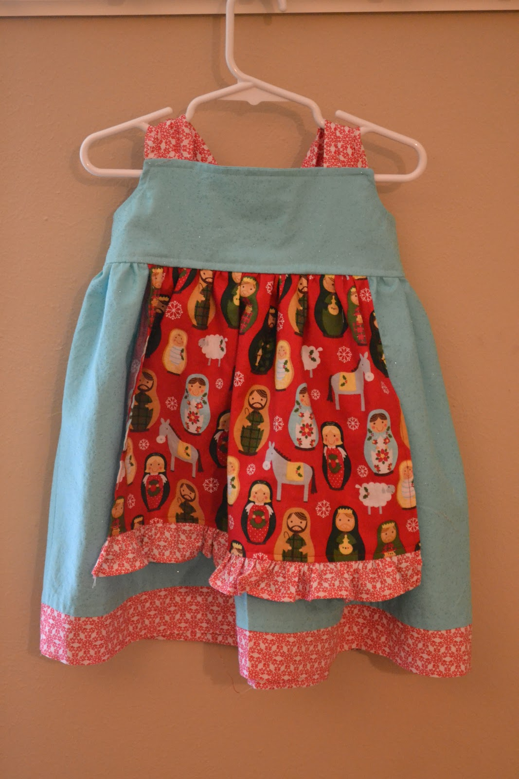 White apron joann fabrics - Is Was Another Situation Where A Cute Fabric Drove The Dress Idea I Happened Upon This Adorable Red Matryoshka Nativity Fabric At Joann S And Thought It