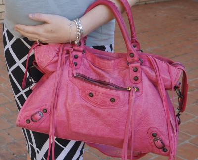 balenciaga pink sorbet city bag worn on arm