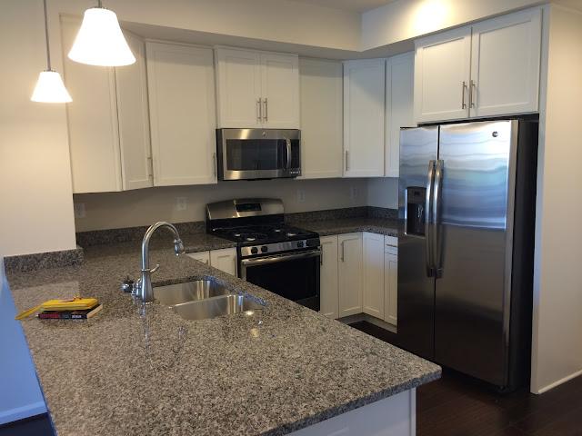 White Sonoma cabinets and New Caledonia granite kitchen