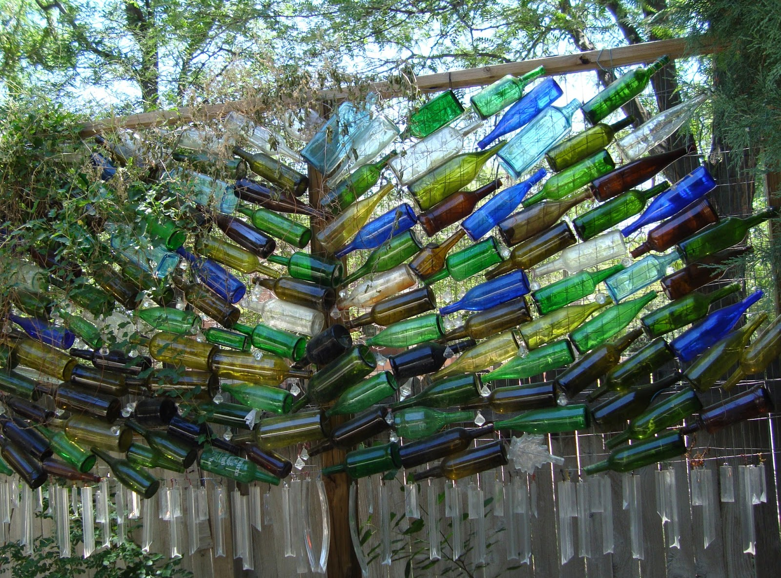 co horts wine bottle art in the garden