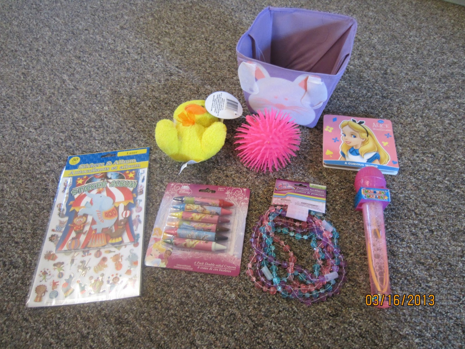 The best is yet to come candy free easter basket for a 1 year old so at the dollar tree we scored her super cute purple easter basket bubbles an alice in wonderland board book a 3 pack of necklaces negle Image collections