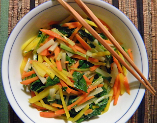 Bowl of Hot Salad with Chopsticks