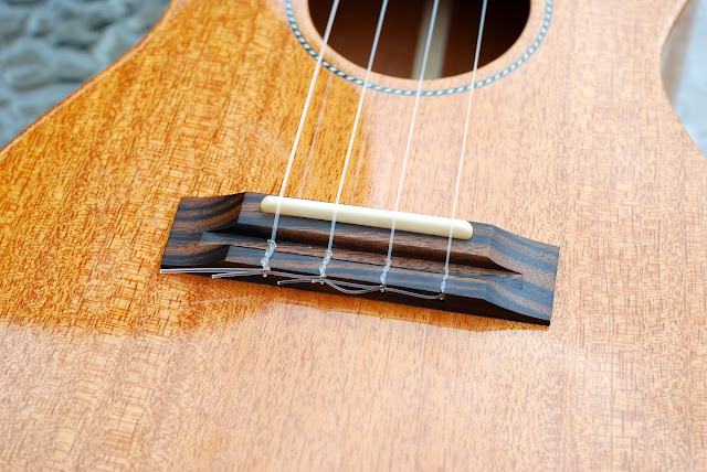Pono MTD-E tenor ukulele bridge