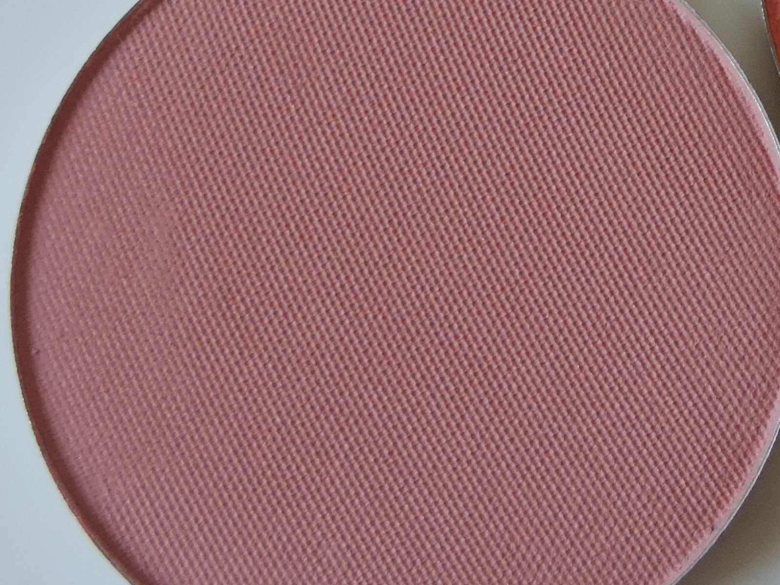 Makeup Geek blush in Spell Bound