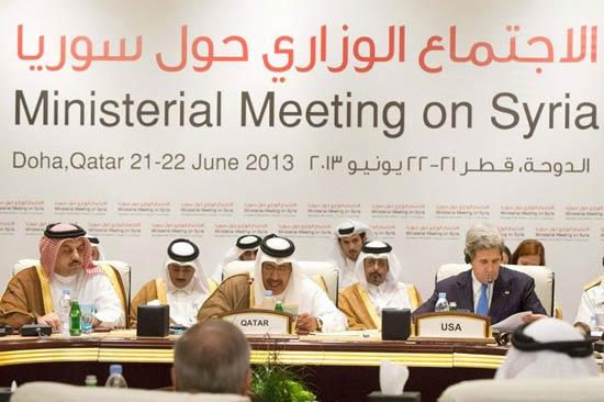 Qatari Prime Minister and Foreign Minister Hamad bin Jassim bin Jabr Al-Thani (C), US  Secretary of State John Kerry (R) and Qatari Minister of State for Foreign Affairs Khalid  bin Mohamed Al-Attiyah (L) attend the ministerial meeting on Syria, in Doha, Qatar, 22 June  2013. The Friends of Syria group of countries is meeting in Qatar to discuss offering  substantial military support to the rebels. The 11-country group is made up of Britain,  France, the United States, Germany, Italy, Jordan, Qatar, Saudi Arabia, Turkey, Egypt and  the United Arab Emirates. [Photo: MAURIZIO GAMBARINI/CFP]