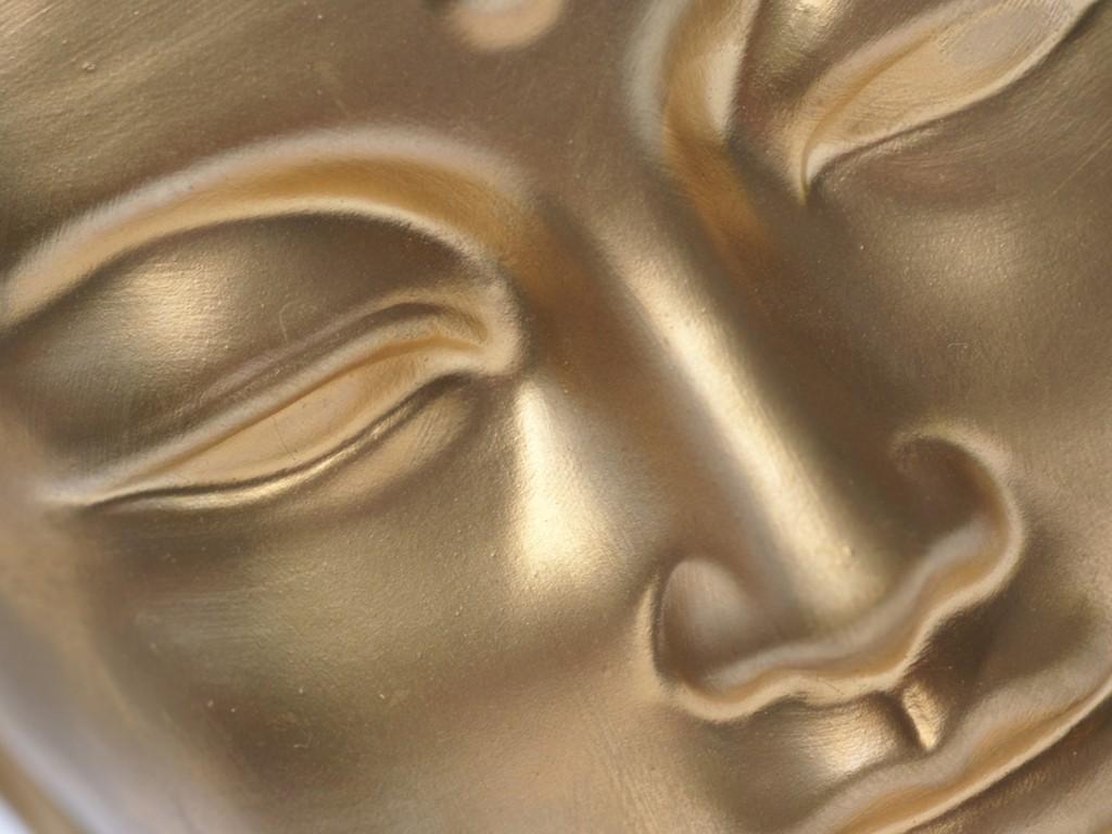 Diagonal Close Up Of Golden Buddhas Face