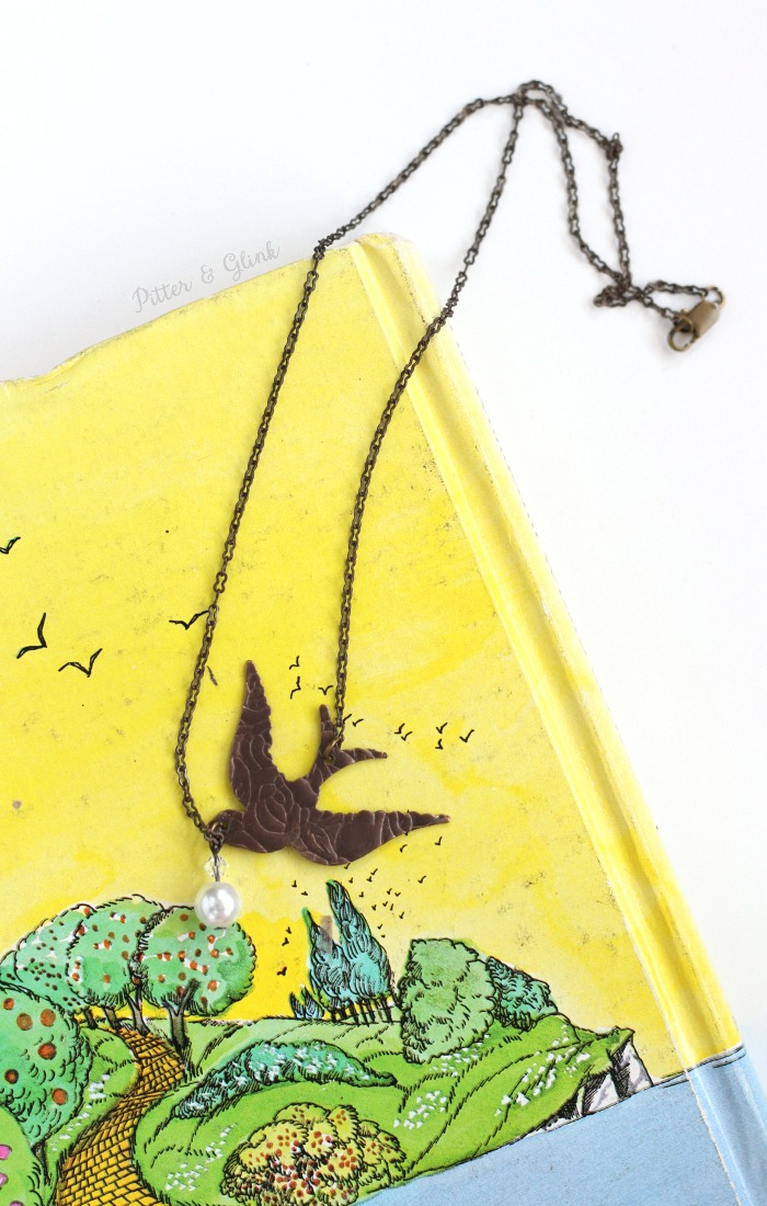 Create an Etched Metal Songbird Necklace Using the Vintaj BIGkick by Sizzix. pitterandglink.com