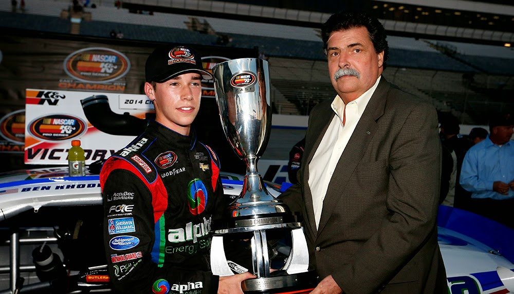 NASCAR President Mike Helton presented Ben Rhodes with the 2014 NASCAR K&N Pro Series East championship trophy Friday at Dover International Speedway.