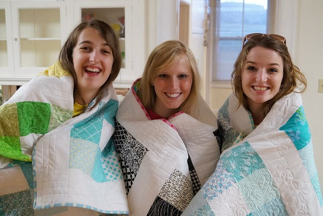 3 Girls Wrapped in Quilts