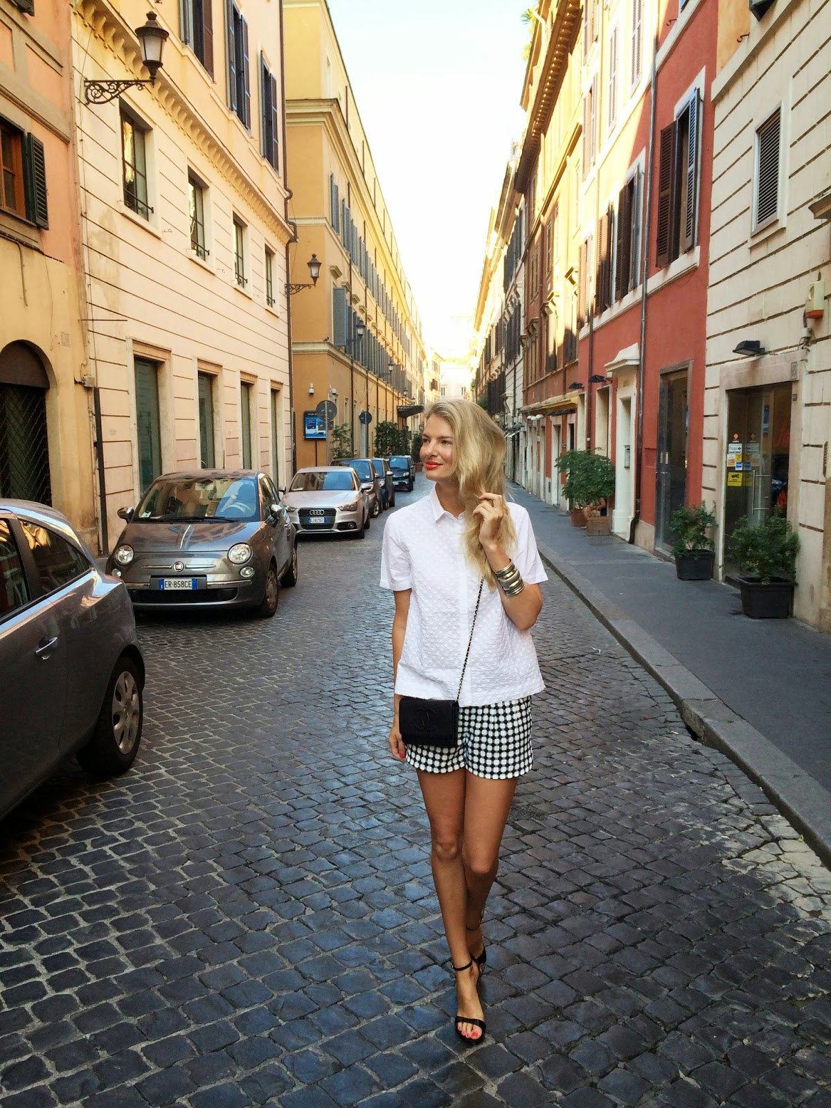 rome street style, street style, windowpane shorts, windowpane print, checked shorts, shorts and sandals, white shirt, gap shirt, styld by gap, chanel bag, chanel clutch, wallet on chain, chanel wallet on chain, unisa sandals, black sandals, rome, rom, roma, italy, travel, monochrome look, fashion blogger, blonde fashion blogger