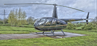 Naik Helikopter