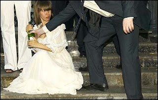 funny wedding picture: Bride drunk and does not let go bottle of wodka