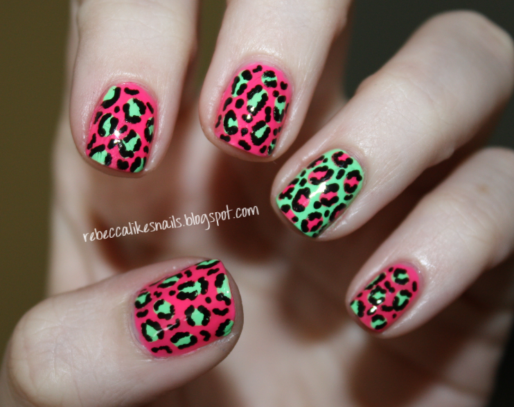 so of course i went for leopard print this is 2 coats of each color alternating dots with a dotting tool and then black detailing with a 2 way nail art - Animal Pictures Print Color