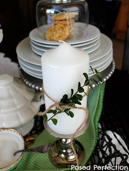 White Candle with Sprig of Greenery