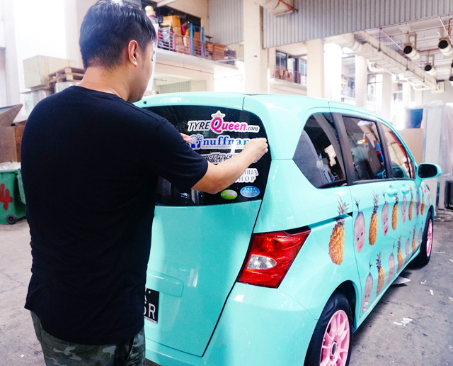 Heres boss alvin sticking stickers on my freshly sprayed honda freed omg its so bloody cute cannot take it gonna puke rainbows