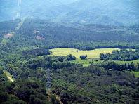 Camps de Sant Feliu de Planeses des del Coll Pedrís