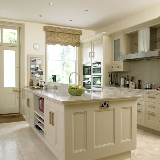 New home interior design traditional kitchen for Cream kitchen cupboards