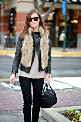 fur vest worn with leather jacket