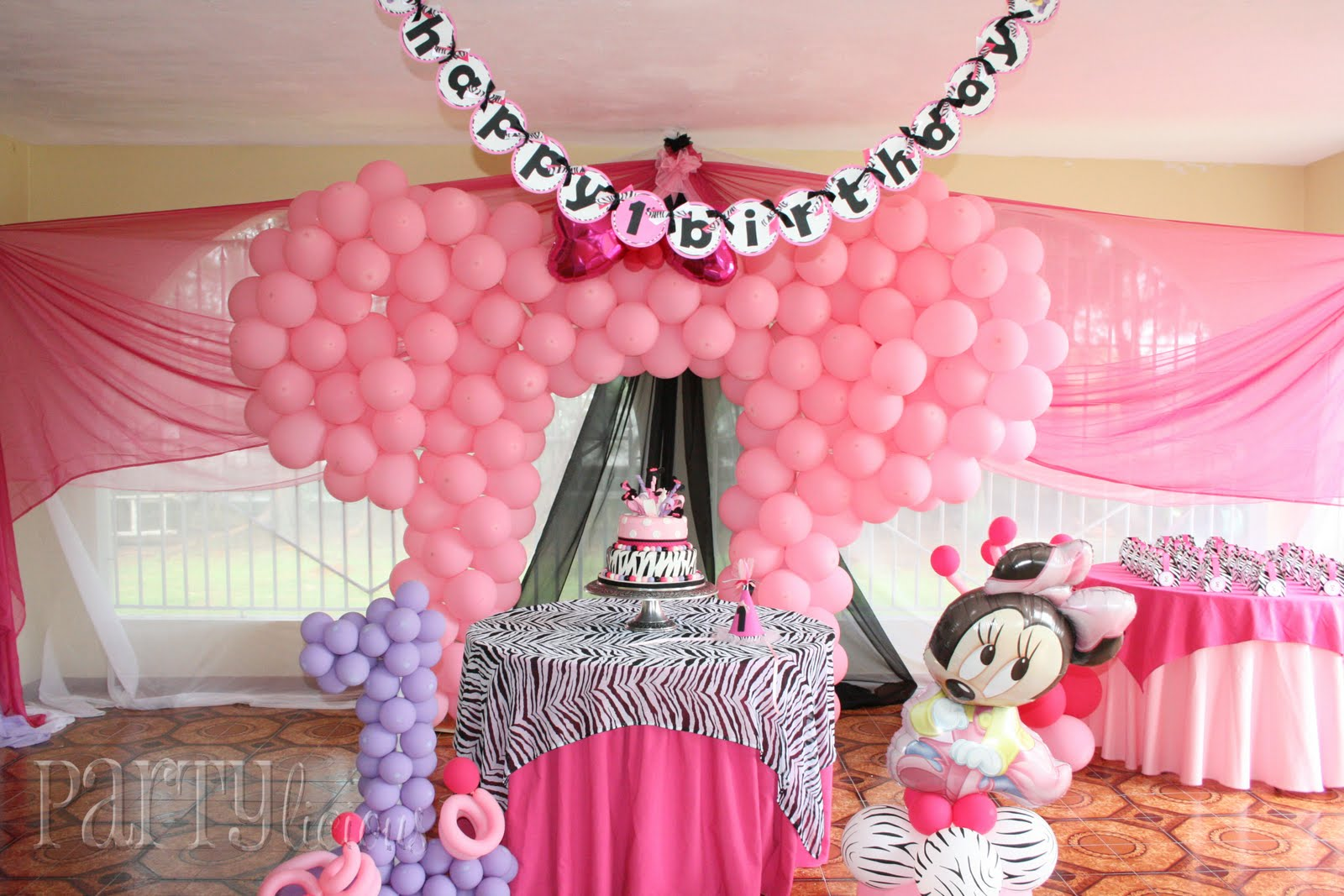 Partylicious events pr zebra pink baby minnie birthday for Baby minnie mouse party decoration