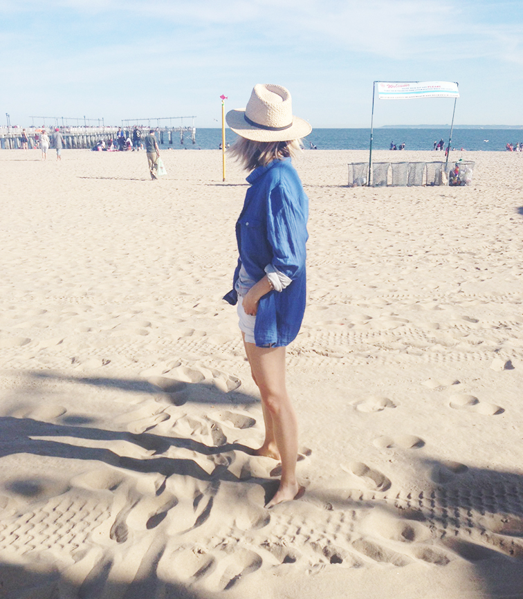 Beach chillin, laid back, casual attitude, straw hat, oversized shirt, Coney Island pier on the beach, Brooklyn NY