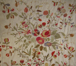 A wonderful old applique quilt.