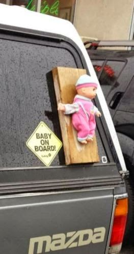 doll attached to board for baby on board