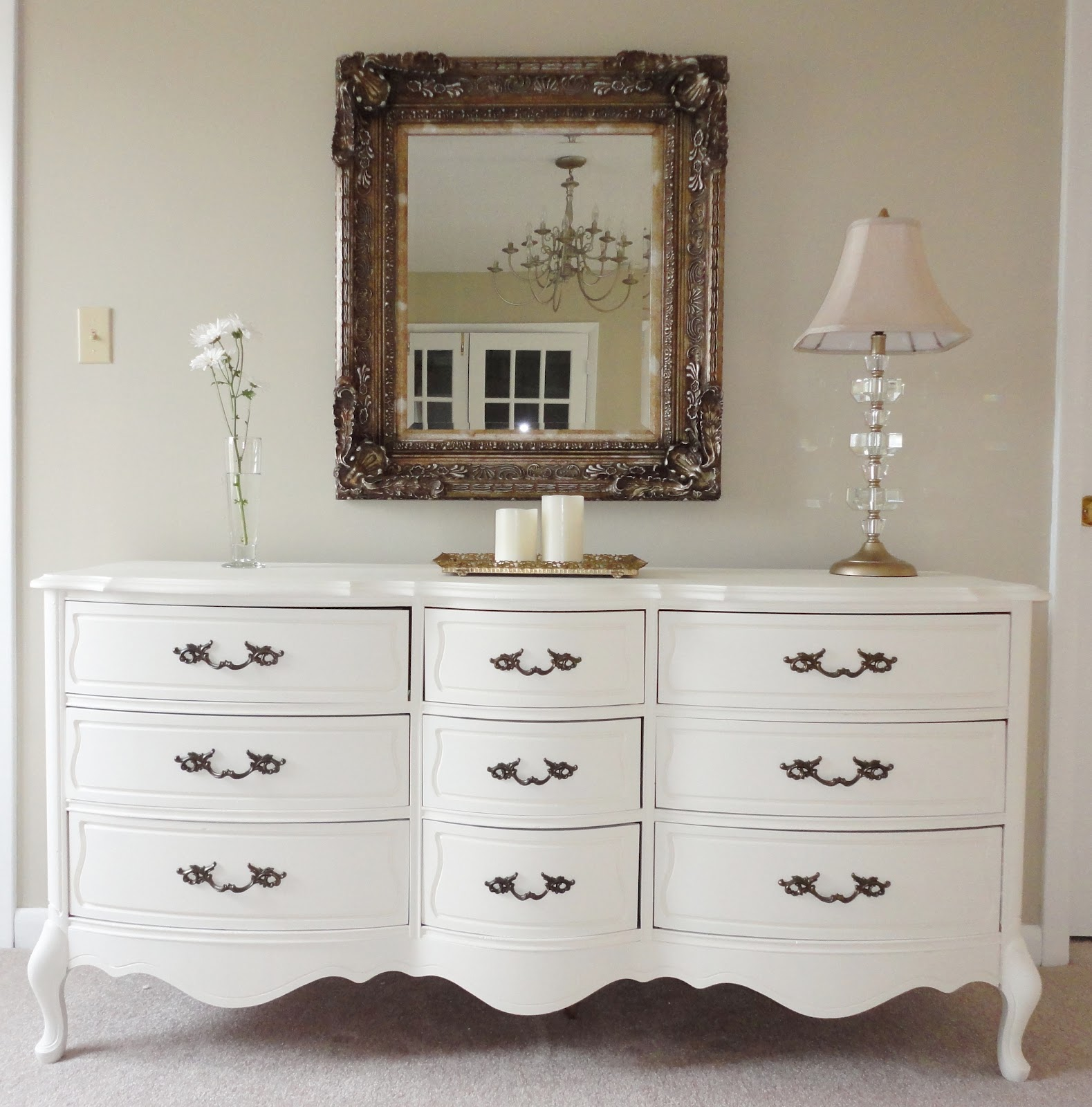 I usually change out the hardware when I redo furniture, but the hardware  on this piece was pretty, so I just left it alone. - LiveLoveDIY: The Beginner's Guide To Painting Furniture