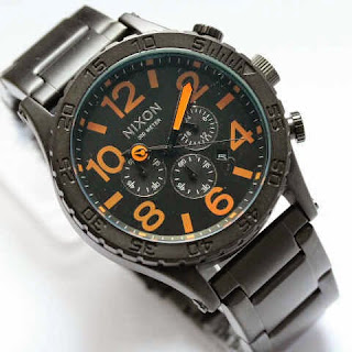 Nixon Monster hitam orange