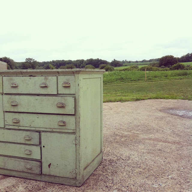 scovill green industrial work bench dresser with one door and 11 drawers of varying size