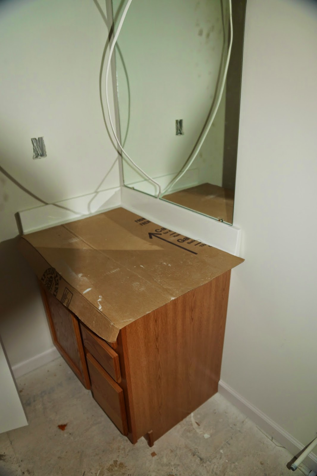 Picture of the upstairs hallway bathroom cabinet