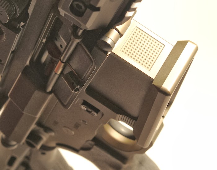 Mag well grip, index finger rest