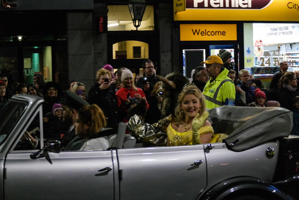 Panto princess waving from open top car