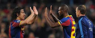 Carles Puyol y Éric Abidal