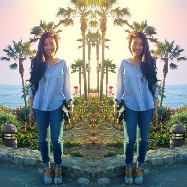 Stephanie Liu of Honey & Silk wearing Madewell shirt, Paige jeans, 3.1 Phillip Lim Cody heels, and vintage purse in Laguna Beach
