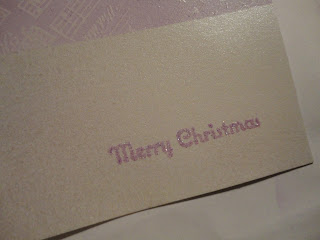 Purple embossed Merry Christmas sentiment