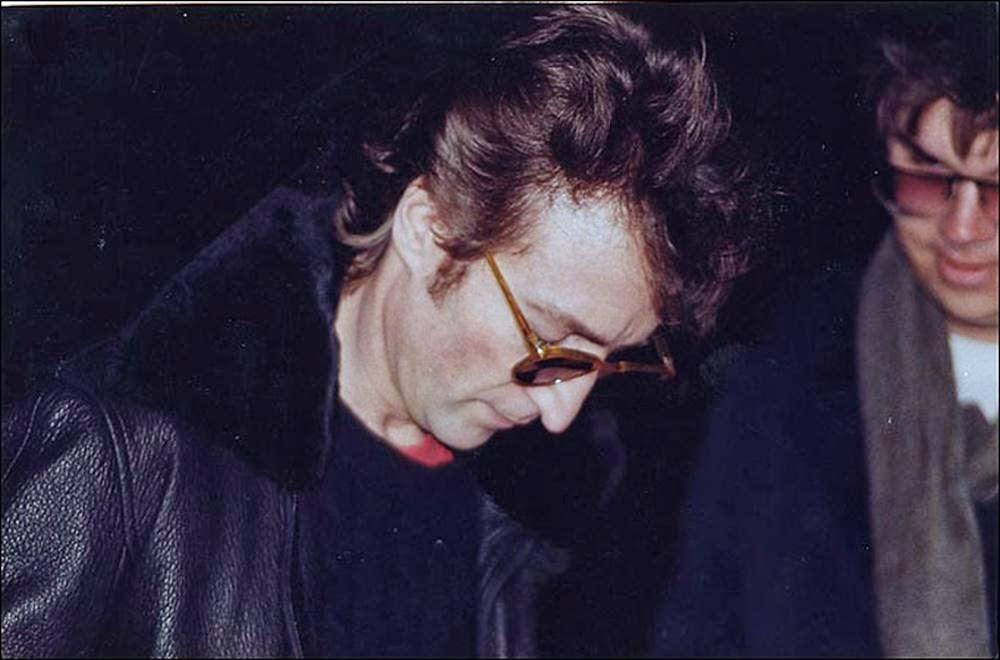 John Lennon signs an autograph for Mark Chapman, his murderer.