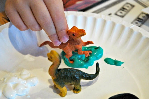 using dinosaurs to paint