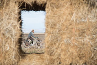 riding among bales of hay