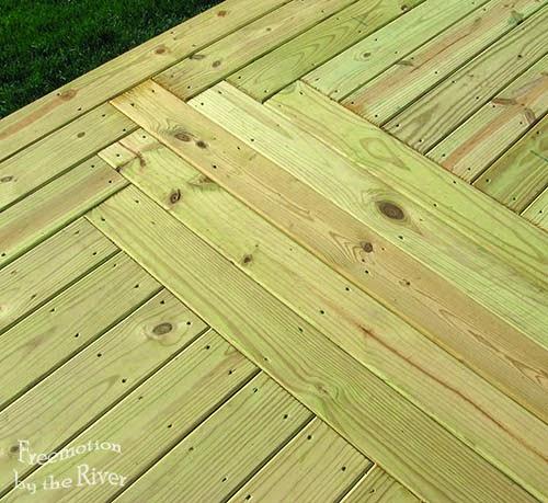 Log cabin center design in a deck