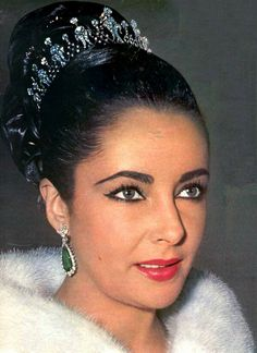 Elizabeth Taylor wearing her diamond tiara with emerald earrings