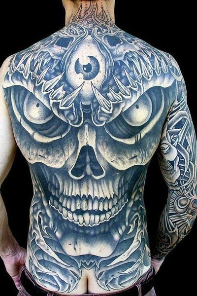Awesome evil skull with eye tattoo on whole back