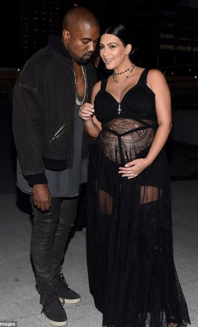 Photos: Kim K puts her baby bump on display in sheer dress 2C33FF3100000578-3231562-Kim_teamed_the_cleavage_boosting_garment_with_leather_thigh_high-m-108_1442020417948