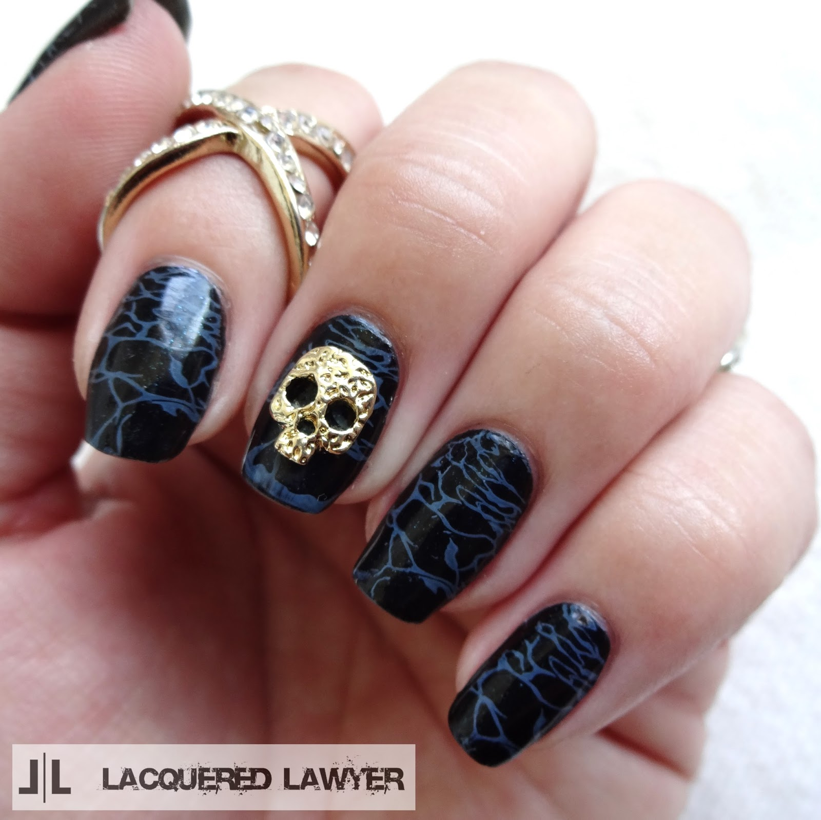 Black sea nail art with skull charm