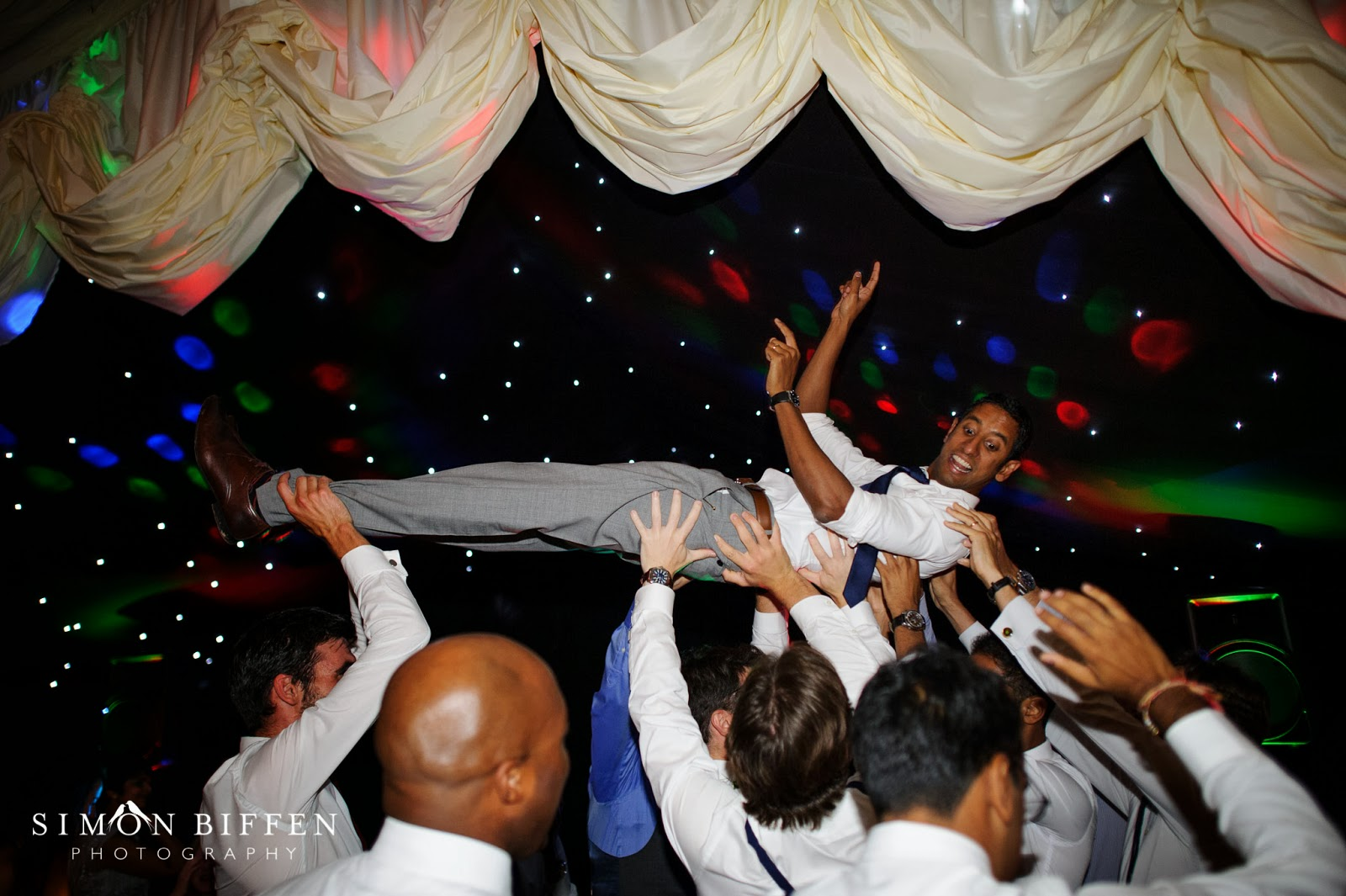 Groom carried on the dancefloor