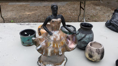 Raku fired pottery sculpture with glazed and unglazed areas.