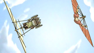 Teo, a boy in a wheelchair with a gliding contraption attached on top, tilted left parallel to Aang, tilted right under his glider fan, both soaring against a bright blue sky